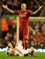 Liverpool's Martin Skrtel appeals to the referee after tackling Fulham's Pavel Pogrebnyk during their English Premier League match at Anfield in Liverpool, on May 1. Liverpool host Chelsea next, on Tuesday