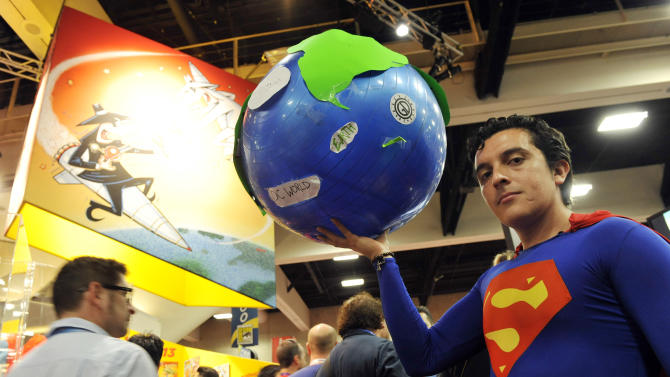 """Bersain Gutierrez of Mexico City poses as """"Superman"""" on the convention floor during the Preview Night event on Day 1 of the 2013 Comic-Con International Convention on Wednesday, July 17, 2013 in San Diego, Calif. (Photo by Chris Pizzello/Invision/AP)"""