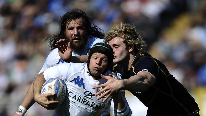Italy's Kristopher Burton (C) is tackeld by Scotland's Richie Gray during their Rugby Union Six Nations match at the Rome's Olympic stadium on March 17, 2012. Italy defeated Scotland 13-6.  AFP PHOTO / FILIPPO MONTEFORTE (Photo credit should read FILIPPO MONTEFORTE/AFP/Getty Images)