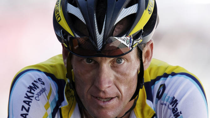 FILE - In this July 19, 2009, file photo, Lance Armstrong crosses the finish line during the 15th stage of the Tour de France cycling race in Verbier, Switzerland. Armstrong confessed to using performance-enhancing drugs to win the Tour de France during a taped interview with Oprah Winfrey that aired Thursday, Jan. 17, 2013, reversing more than a decade of denial. (AP Photo/Laurent Rebours, File)