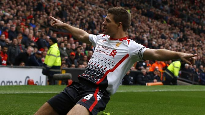 Liverpool's Gerrard celebrates scoring his second penalty against Manchester United during their English Premier League soccer match in Manchester