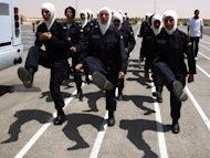 Jordanian policewomen are put through their paces at the al-Muwaqr academy. FIFA, world football's governing body, banned players from wearing the Islamic headscarf in 2007, claiming it is unsafe, but the International Football Association Board (IFAB) allowed women players last month to wear the hijab in games
