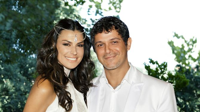 In this photo, taken Saturday, May 26, 2012 and released by Rondene Public Relations Tuesday, May 29, 2012, newlyweds Alejandro Sanz and Raquel Perera pose for a photo at an undisclosed location in Spain. The couple were married in a religious ceremony in Barcelona on Wednesday, May 23, 2012 and then renewed their vows on Saturday, coinciding with the christening of his son, Dylan.   (AP Photo/Rondene Public Relations)