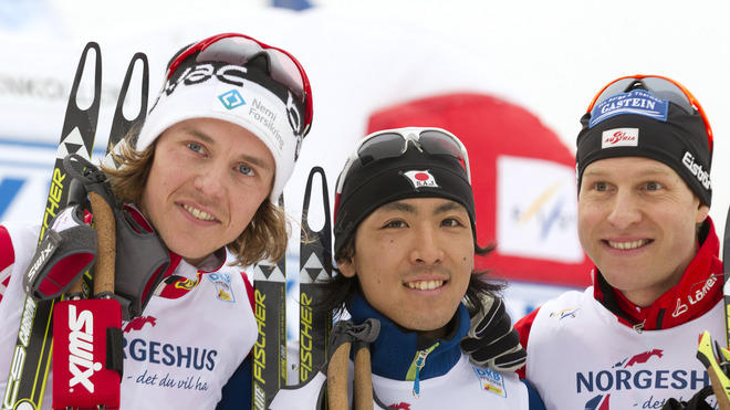 Japanese Akito Watabe (C) Celebrates His Victory With Second-placed Norwegian Mikko Kokslien And Third-placed Austrian AFP/Getty Images
