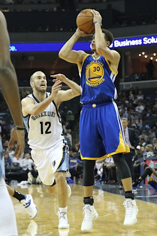 Mar 27, 2015; Memphis, TN, USA; Golden State Warriors guard Stephen Curry (30) attempts a shot in the second half against Memphis Grizzlies guard Nick Calathes (12) at FedExForum. Warriors defeated the Grizzlies 107-84. (Nelson Chenault-USA TODAY Sports)