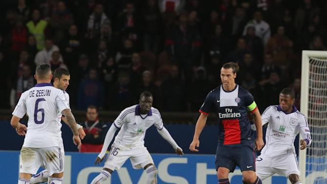 PSG's Zlatan Ibrahimovic, 2nd right, is surrounded by Anderlecht's players during their Champions League group C soccer match in Paris, France, Tuesday, Nov. 5, 2013