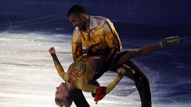 German pair, Aliona Savchenko (L) and Robin Szolkowy perform during the exhibition event in the World Team Trophy 2012 figure skating competition in Tokyo on April 22, 2012.   AFP PHOTO / TOSHIFUMI KITAMURA (Photo credit should read TOSHIFUMI KITAMURA/AFP/Getty Images)