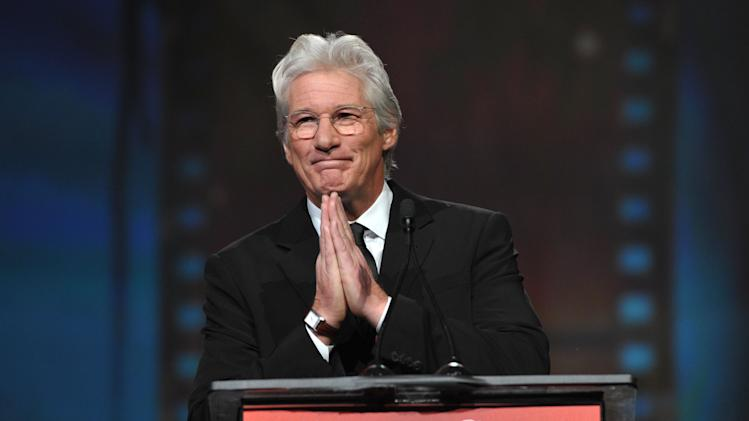 Richard Gere appears on stage at the 24th Annual Palm Springs International Film Festival Awards Gala on Saturday, Jan. 5, 2013 in Palm Springs, Calif. The gala honors individuals in the film industry with awards for acting, directing, achievement in film scoring and lifetime achievement. (Photo by John Shearer/Invision/AP Images)