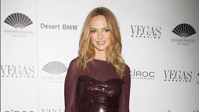Heather Graham poses for photographs as she is the new cover model to celebrate Vegas Magazine's 10th Anniversary May issue at the Mandarin Oriental Hotel in Las Vegas
