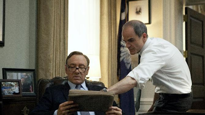 """In this image released by Netflix, Kevin Spacey, left, and Michael Kelly appear in a scene from """"House of Cards."""" The third season of the political drama will be available on Netflix on Friday Feb. 27, 2015. (AP Photo/Netflix)"""