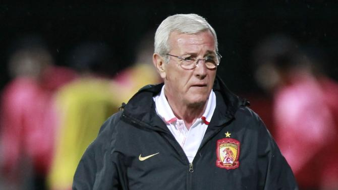Marcello Lippi, coach of China's Guangzhou Evergrande, attends a training session in Agadir Stadium, Agadir