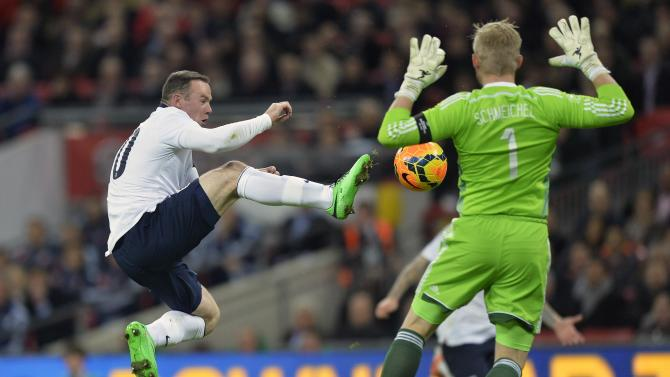 England's Rooney challenges Denmark's Schmeichel during their international friendly soccer match at Wembley stadium in London