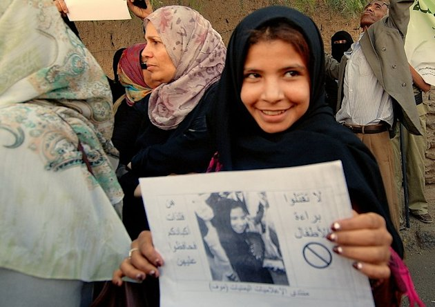 Yemeni former child bride Nujud Mohammed Ali protests in support of a child marriage ban outside the parliament in Sanaa on March 23, 2010. Yemen's rights minister said Saturday that she will press for the minimum age of marriage to be raised to 18, after the reported death of a young girl on her wedding night