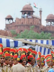 Delhi policemen wait for Indian Prime Minister Manmohan Singh to form a guard of honour on India's 66th Independence Day at the Red Fort in New Delhi on August 15, 2012. Police said no one was injured when four roadside bombs exploded in the northeastern state of Manipur, which has seen decades of separatist violence