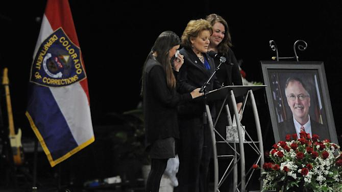 Supported by her daughters Sara, left, and Rachel, Lisa Clements, the widow of Tom Clements, speaks at his public memorial at New Life Church in Colorado Springs, on Monday, March 25, 2013. Corrections officials and guards from as far away as Morocco are among the hundreds of people who turned out Monday to honor Clements, killed March 19 when he answered the door of his home in a wooded, rural area north of Colorado Springs. (AP Photo/The Gazette, Jerilee Bennett, Pool)