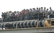 Indonesian authorities evacuate asylum seekers off a tanker in Merak port in April 2012. Australia's parliament neared agreement to transfer boatpeople seeking asylum to Pacific states, with Prime Minister Julia Gillard saying they could be processed offshore within a month