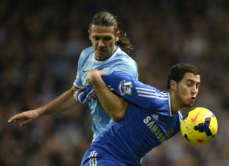 Chelsea's Hazard is challenged by Manchester City's Demichelis during their English Premier League soccer match at the Etihad Stadium in Manchester