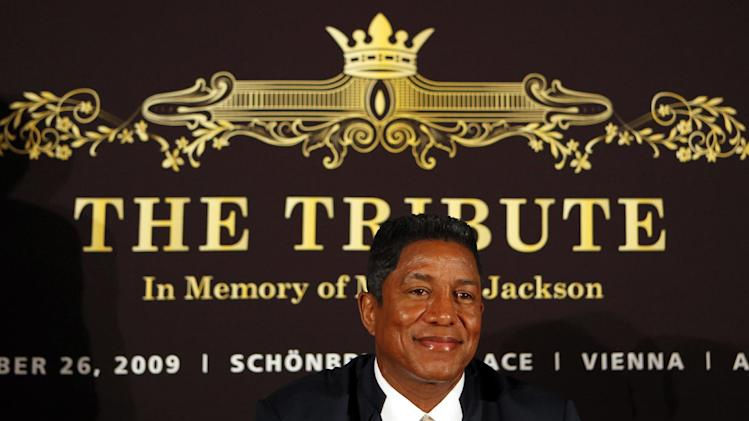 "FILE - In this Sept. 10, 2009 file photo, Jermaine Jackson, bother of late U.S. pop star Michael Jackson, smiles prior to a press conference on ""The Tribute - In Memory of Michael Jackson"" in Berlin. Concert giant AEG Live filed a motion on Monday, Sept. 10, 2012 seeking Jermaine Jackson's drafts and manuscripts for books on his superstar brother, claiming they may reveal important details that will help it defend against a lawsuit filed by Jackson family matriarch Katherine Jackson. (AP Photo/Franka Bruns, File)"