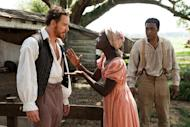 "This image released by Fox Searchlight shows Michael Fassbender, left, Lupita Nyong'o and Chiwetel Ejiofor, right, in a scene from the film, ""12 Years A Slave."" The film has nine Academy Awards nominations, including Nyong'o nominated for her performance by an actress in a supporting role. (AP Photo/Fox Searchlight, Francois Duhamel, file)"