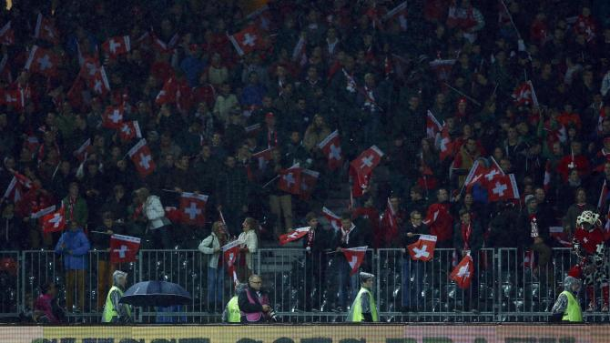 Switzerland fans celebrate defeating Slovenia during 2014 World Cup qualifying soccer match in Bern