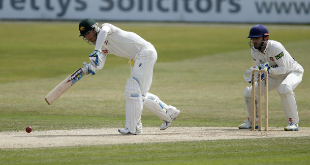 CRIC: Australia's Michael Clarke in action as Essex's James Foster (R) looks on
