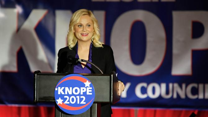 """This image released by NBC shows Amy Poehler as Leslie Knope in a scene from """"Parks and Recreation.""""  Knope, a dedicated public servant in fictional Pawnee, Ind., used to be Deputy Parks Director, but at the end of last season, she won a seat on the Pawnee City Council. The high drama of this political season has been echoed by episodic TV like CBS' """"The Good Wife,"""" and Showtime's """"Homeland"""" where character Nicholas Brody returns home after eight years' imprisonment in Afghanistan and becomes a U.S. Congressman. (AP Photo/NBC, Tyler Golden)"""