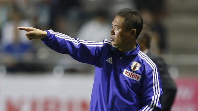 Japan's women's national soccer team head coach Sasaki directs his players during their women's international friendly soccer match against Italy in Nagano, central Japan