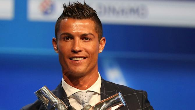Real Madrid's Cristiano Ronaldo of Portugal poses with the Best Player UEFA 2015/16 Award during the draw ceremony for the 2016/2017 Champions League Cup soccer competition at Monaco's Grimaldi in Monaco
