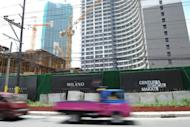 Commuters are seen driving past a high-rise building construction site in Manila. As a Philippine property boom gathers pace, even Paris Hilton, Donald Trump and high-fashion house Versace are getting a piece of the action