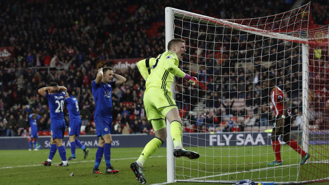 Sunderland's Jordan Pickford celebrates after making a save as Leicester City players look on dejected