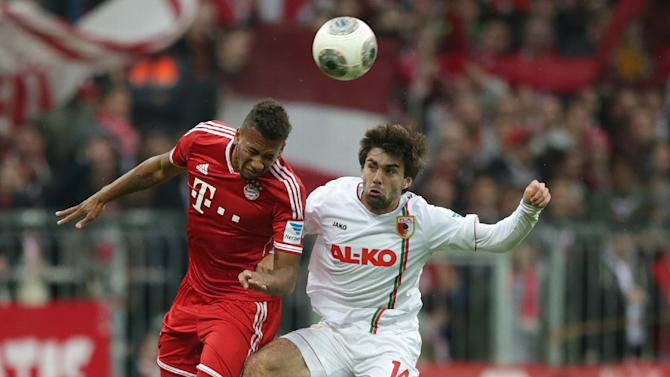 Bayern's Jerome Boateng, left, and Augsburg's Jan Moravek of Czech Republic challenge for the ball during the German first division Bundesliga soccer match between FC Bayern Munich and FC Augsburg, in Munich, southern Germany, Saturday, Nov. 9 2013