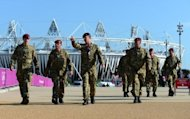 British soldiers walk near the Olympic stadium at the Olympic Park in London. London Mayor Boris Johnson insisted Sunday the city was ready to host the 2012 Olympics despite a national outbreak of pre-match nerves before the biggest show on Earth gets under way