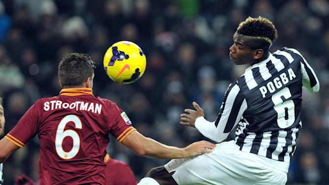 Juventus midfielder Paul Pogba, of France, right, jumps for the ball with AS Roma midfielder Kevin Strootman, of The Netherlands, during a Serie A soccer match between Juventus and AS Roma at the Juventus stadium, in Turin, Italy, Sunday, Jan. 5, 2014