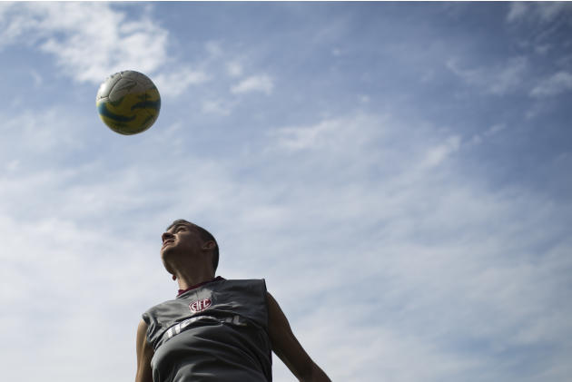 America's soccer player Russo, 18, heads the ball during practice at the America Football club on the outskirts of Rio de Janeiro, Brazil, Friday, May 29, 2015. The accused in the FIFA scandal are