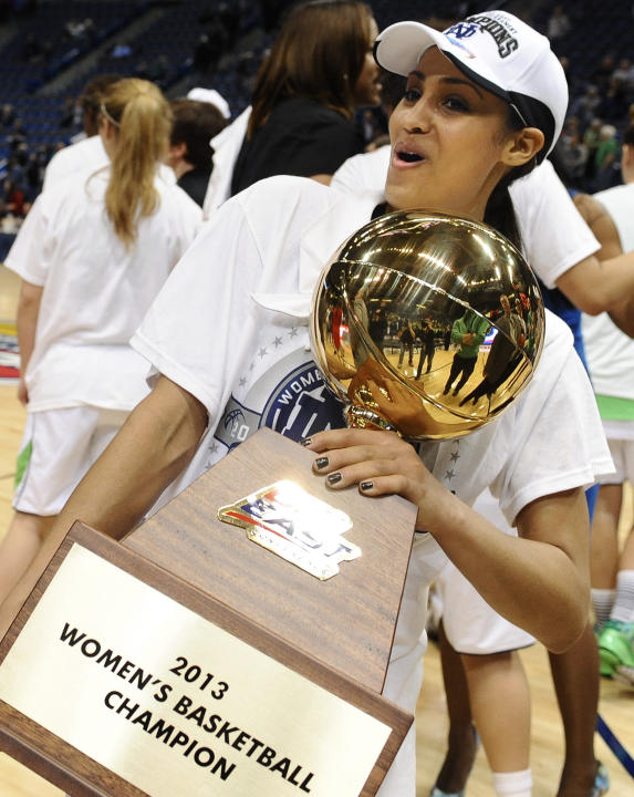 Notre Dame's Skylar Diggins holds up the Big East Conference women's tournament championship trophy after their 61-59 win over Connecticut in an NCAA college basketball game in Hartford, Conn., Tuesda