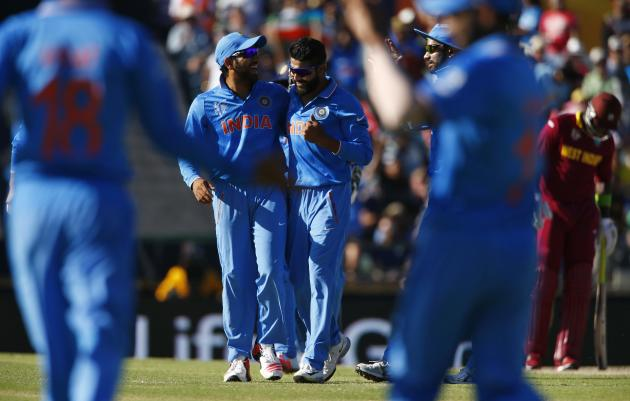 India's Rohit Sharma and  Ravindra Jadeja celebrate the dismissal of West Indies batsman Andre Russell during their Cricket World Cup match in Perth