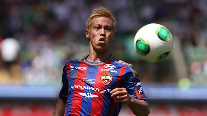 "In this June 1, 2013 file photo, CSKA Moscow's Keisuke Honda watches the ball during a Cup of Russia final match between CSKA Moscow and Anzhi in the Akhmad Arena stadium in Grozny, Russia. AC Milan says CSKA Moscow and Japan forward Keisuke Honda will join the club in January and will be given the number 10 shirt. It has long been reported that Honda would arrive in the winter transfer window and on Wednesday Milan vice president Adriano Galliani says ""now we can talk. From the 3rd of January 2014 Keisuke Honda will be a Milan player"