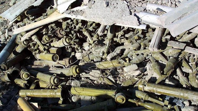 Hundreds of unexploded anti-tank rockets lie on the ground inside the bombed compound of Osama bin Laden in Jalalabad, Afghanistan, on November 18, 2001