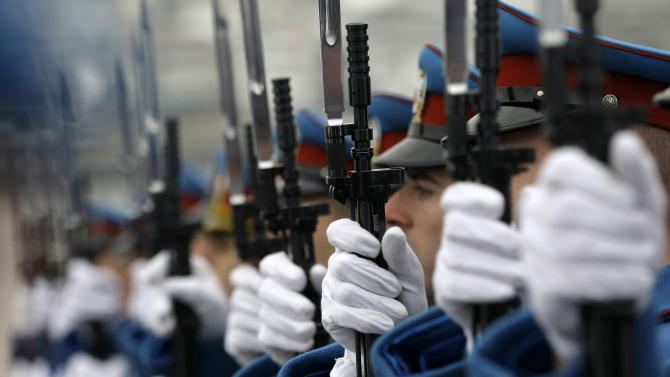 Serbian military honor guards participate in commemorations for victims of the Holocaust at the former World War II Nazi concentration camp of Sajmiste in Belgrade, Serbia, Sunday, Jan. 27, 2013. The ceremony coincided with International Holocaust Remembrance Day, which marks the liberation of the Auschwitz Nazi concentration camp on Jan. 27, 1945. (AP Photo/Darko Vojinovic)