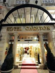 The entrance to the Hotel Carlton in the northern French city of Lille. A probe into allegations that Dominique Strauss-Kahn procured prostitutes for sex parties will continue after a French court rejected a request for pimping charges against the former IMF chief to be dismissed. French prosecutors allege business leaders supplied vice girls for sex parties at the hotel.