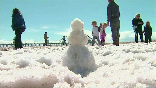 Hail piles up on California beach