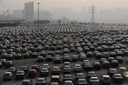 New cars are seen at a parking lot of Changan Ford Mazda Automobile Co. Ltd, Ford Motor's joint venture in China, in Chongqing Municipality January 8, 2010. REUTERS/Stringer