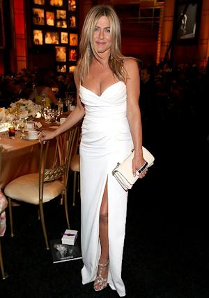 Jennifer Aniston Flaunts Cleavage, Long Legs in Sexy White Dress