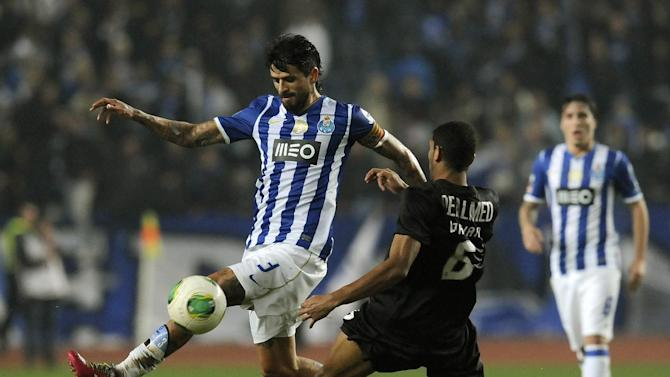 FC Porto's Lucho Gonzalez, from Argentina, drives the ball past Academica's Djavan Ferreira, right, from Brazil in a Portuguese League soccer match at the Municipal Stadium in Coimbra, Portugal, Saturday, Nov. 30, 2013. Academica won 1-0 causing Porto's first defeat in the championship