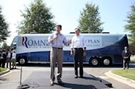 Republican presidential candidate Mitt Romney (R) looks on as his running mate Rep. Paul Ryan speaks to an overflow crowd outside of a campaign rally at the NASCAR Technical Institute in Mooresville, North Carolina. Romney and Ryan took a re-energized Republican presidential campaign to North Carolina Sunday, vowing to fix the US economy and restore American strength