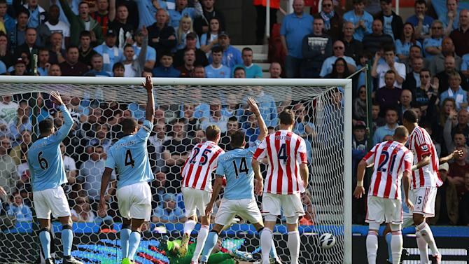 Roberto Mancini says Peter Crouch's, centre, goal against Manchester City belonged in the NBA