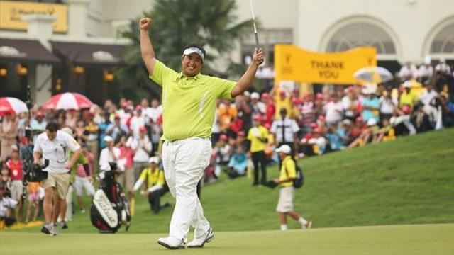 Golf - Aphibarnrat holds off stars to win in Malaysia
