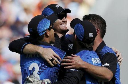 New Zealand's Martin Guptill celebrates with team mates after catching out South Africa's Rilee Russouw during their Cricket World Cup semi final in Auckland