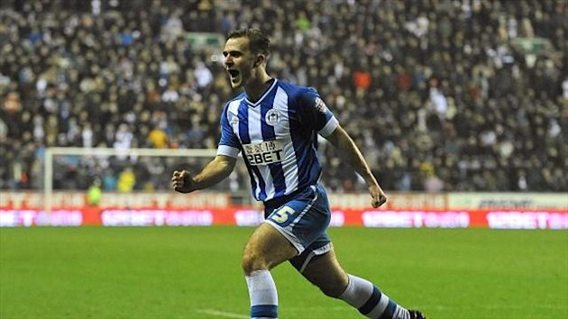 Wigan's Callum McManaman celebrates after scoring the winner against Bolton