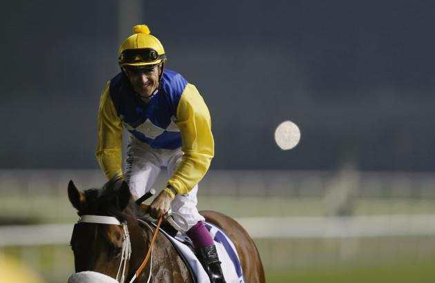 "Soumillon, riding Shea Shea of South Africa, celebrates after winning the fifth race ""Al Quoz Sprint"" during the Dubai World Cup at the Meydan Racecourse in Dubai"